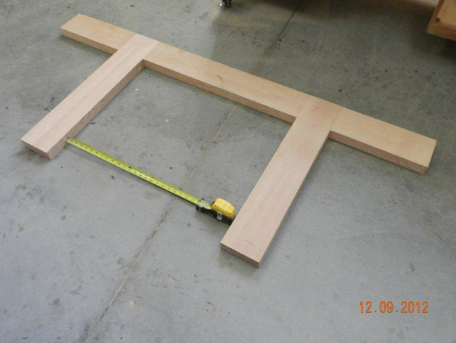 Checking the workbench framework to see if square using the tape measure gauge.