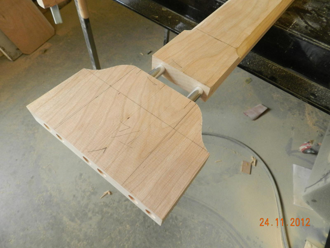 Hall table longitudinal rail modified with end section profile cut with bandsaw