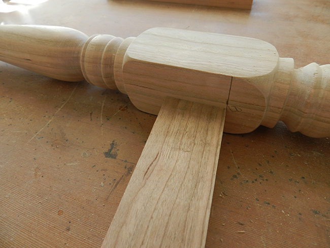 photo of lower rail of stool cut to length with a 6 degree angle at each end to align with the pencil mark on the leg