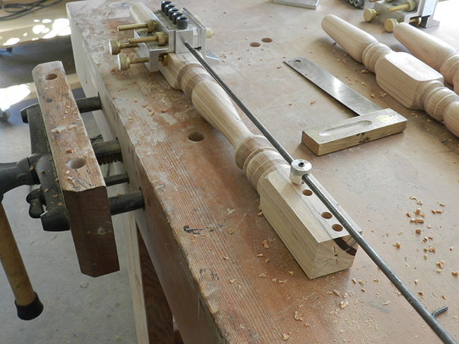 photo of Dowelmax device aligned with extended distance gauge to drill the lower rail to leg joint used to build the stool frame assembly