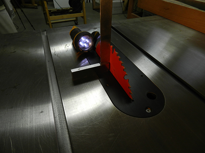 checking-table-saw-blade-is-ninety-degrees-to-bed-plate