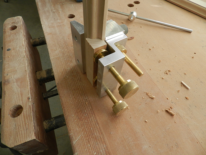 cropped-section-of-mirror-rail-used-for-clamping