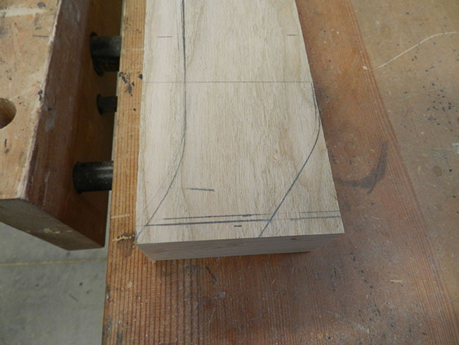 curvature-of-footboard-leg-marked-with-pencil-for-cutting