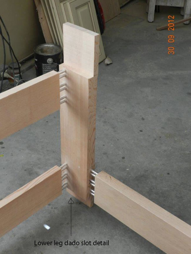 Slot milled into lower leg for joint connection to transverse rail used to support castors.