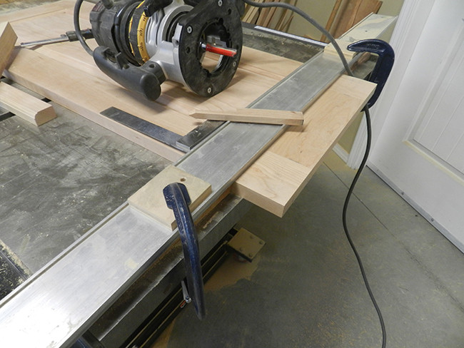 edge-of-raised-panel-for-footboard-trimmed-with-router-aligned-to-fence