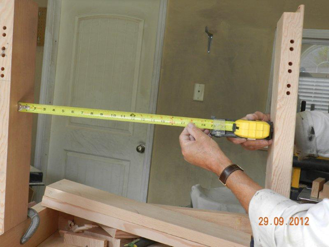 Checking the legs are sitting square using the tape measure gauge.