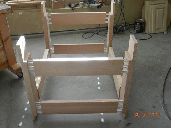 Transverse rails dry fitted to legs using aluminum pins to show joint detail.