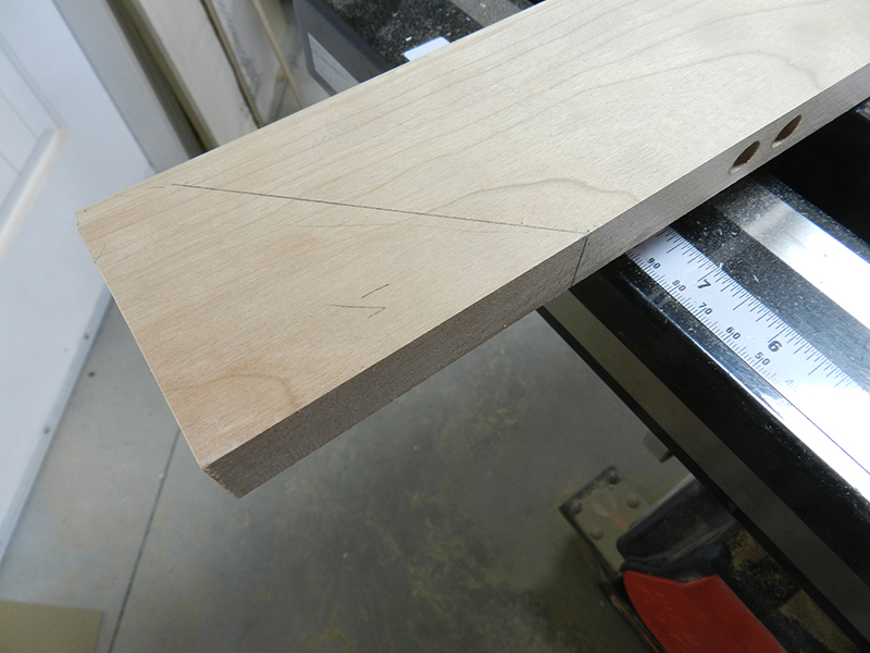 scribed-reference-line-for-drilling-into-mitered-edge-rail-before-cutting-miter