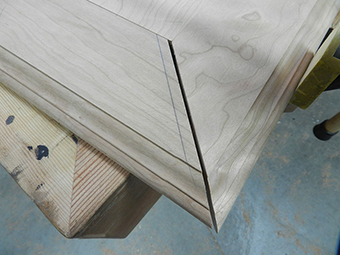 Mitered edge trim for bookcase project shown dry fitted.
