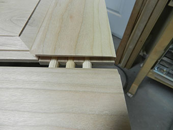 photograph of dowel joint between rail and stile work pieces used to build an armoire raised panel door