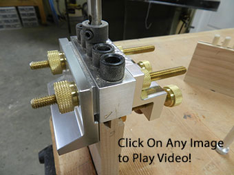 photograph of dowelmax aligned and clamped on stile to drill dowel bores used to build and armoire raised panel door assembly