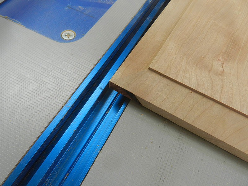 photo of bevel cut on router table into the main panel used to build the armoire drawer assembly front fascia