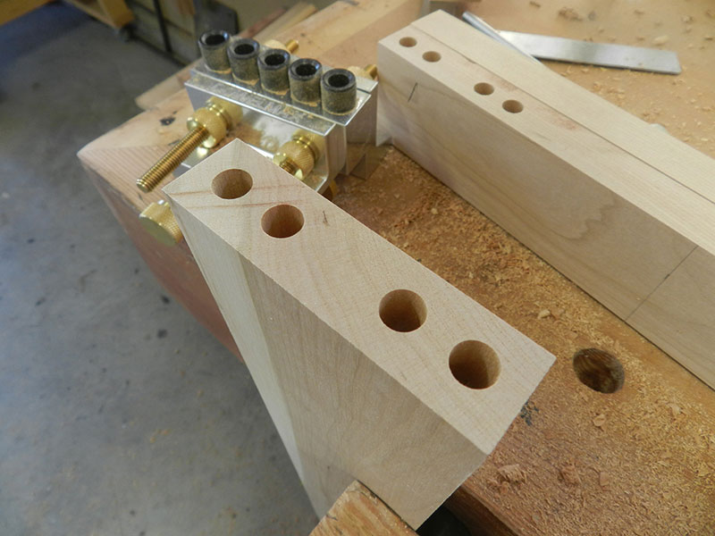 photo of dowel bore detail at end of the top rail used to build the armoire frame assembly front section