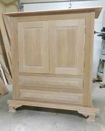 photo of armoire built by Dowelmax inventor Jim Lindsay shown dry fitted in work shop before staining and finishing