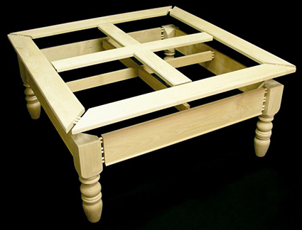 photo of dry fitted coffee table assembly with turned legs built for this project instruction article