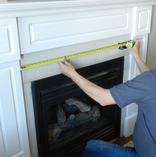 photo of UTG tape measure used to take an accurate inside measurement for fireplace tiles