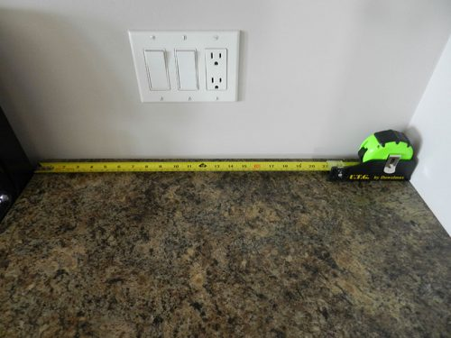photo of UTG tape measure used to take an accurate inside measurement for a replacement counter top
