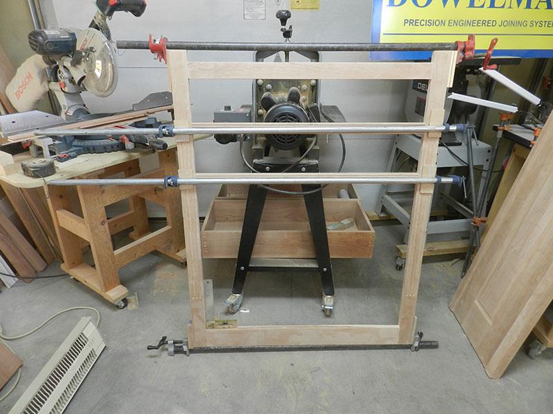 photo of rails and stiles used to build the amoire frame assembly front section shown glued and clamped together