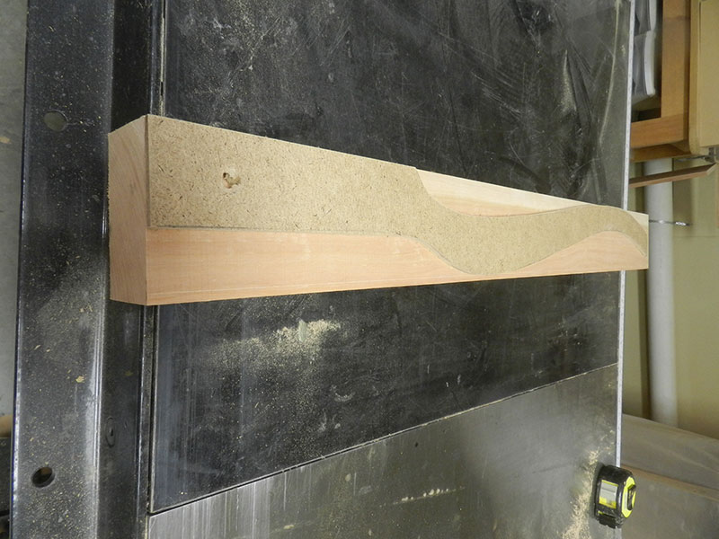 photo of the template made from hardboard for marking the cabriole shape on the work piece used to build the bedside table leg