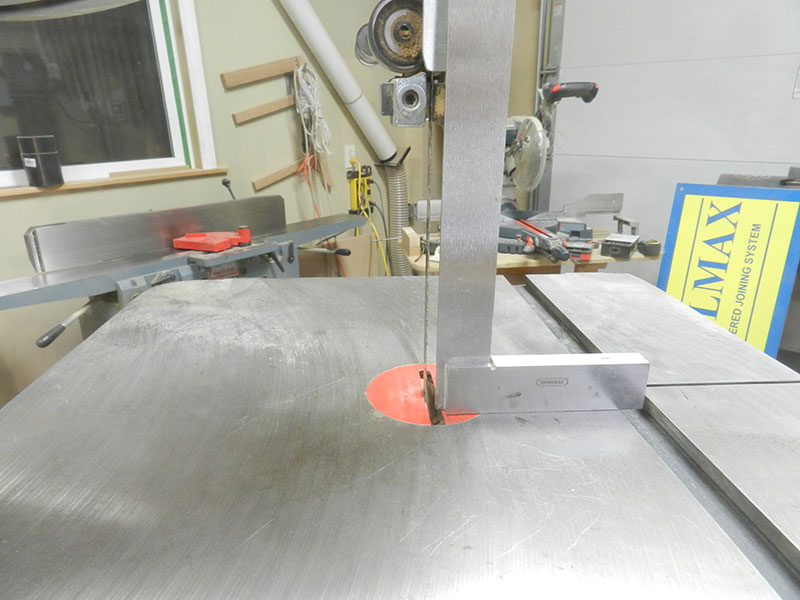 photo of checking the band saw blade perpendicular to the cast iron saw base with a set square prior to cutting the cabriole leg shape