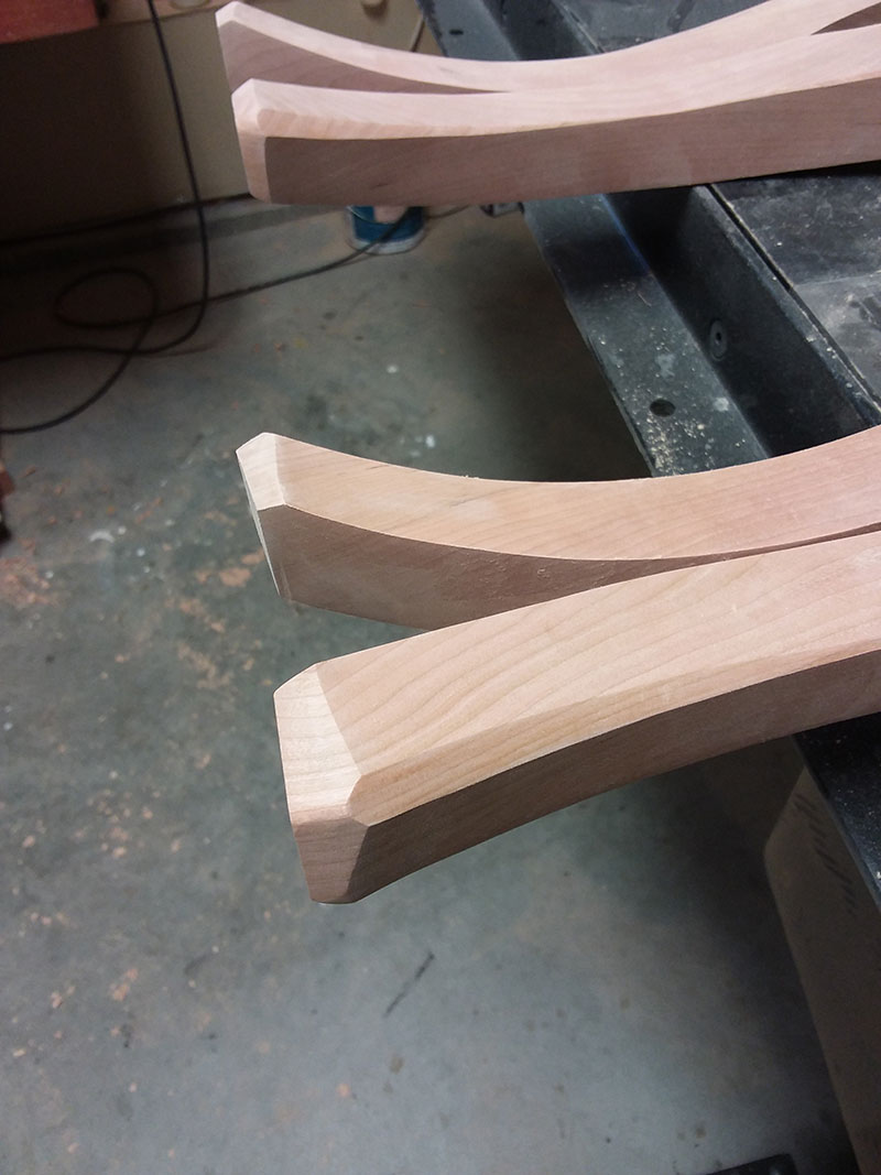 photo of the feet of the cabriole legs used to build the bedroom table frame after shaping with the belt sander and by hand