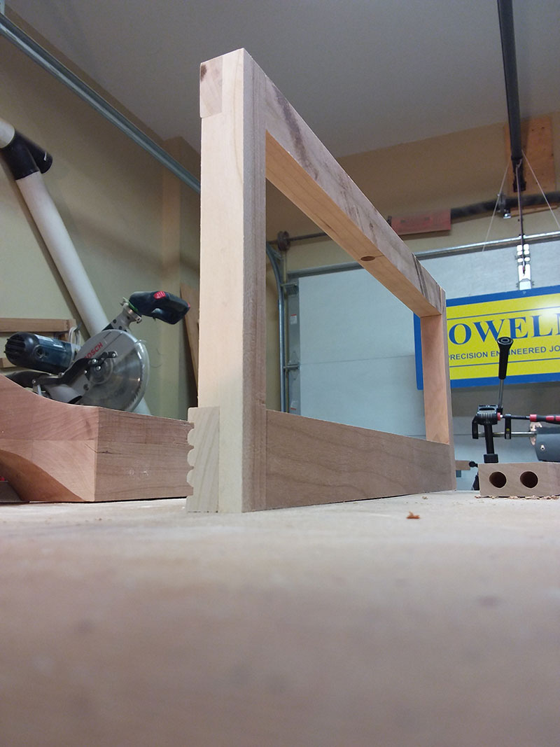 photo of the half lap joints between the rails and stiles used to build the bedroom table drawer fascia assembly