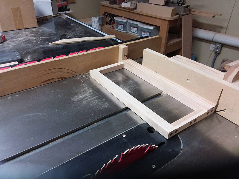 photo of the drawer fascia used to build the bedroom table frame front section trimmed to length in the table saw