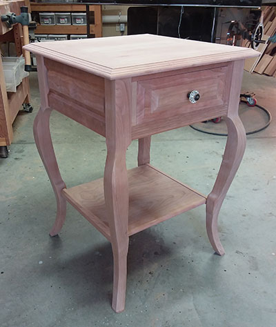 photo of bedside table built by Dowelmax inventor Jim Lindsay for this project article shown dry fitted in work shop before staining and finishing