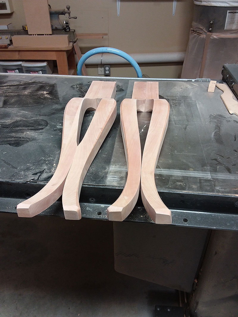 photo of the cabriole legs used to build the bedroom table frame assembly, front legs on the right and rear legs on the left