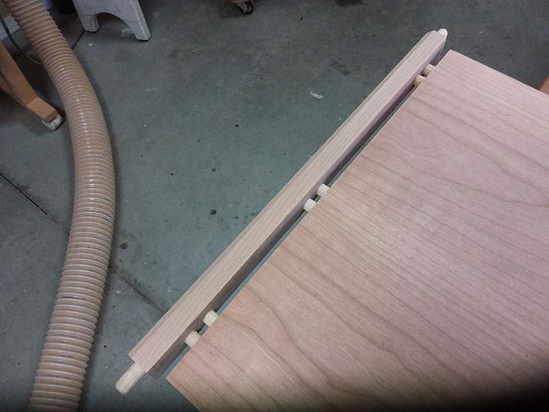 photo of the lower rail rail to shelf dowel joint used to build the bedside table frame assembly lower section