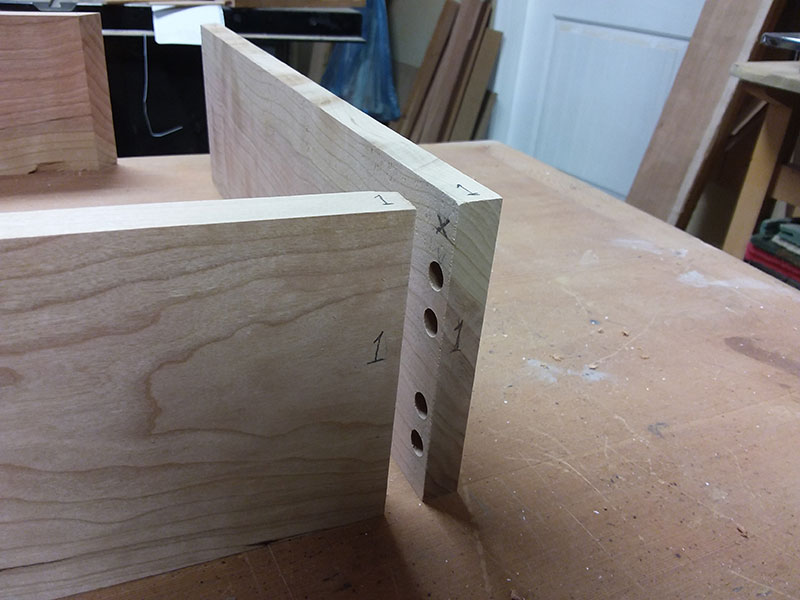 photo of referencing system numbers for the multiple dowel joint used to build the bedside table drawer wall rear section