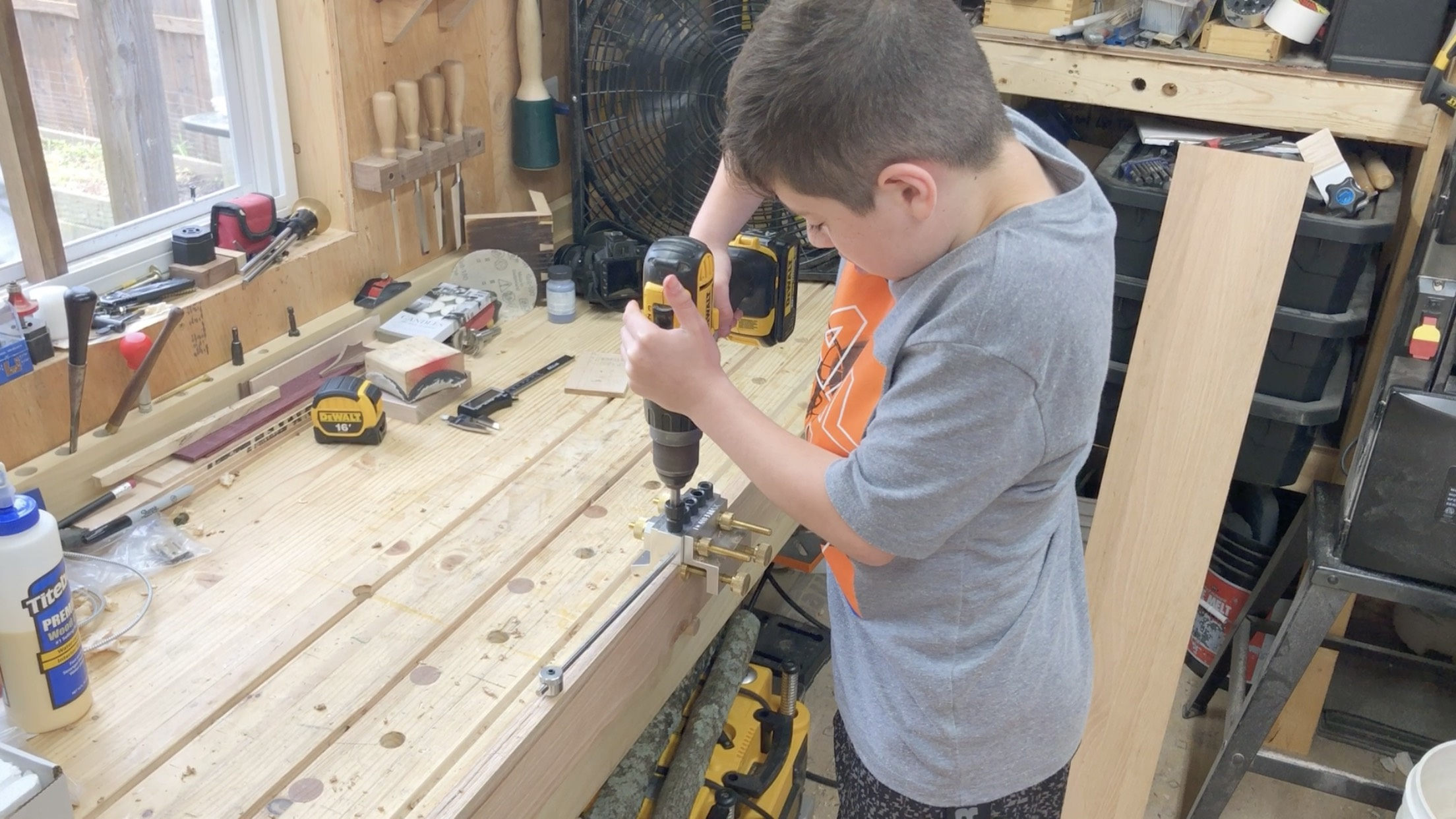 Hunter A. using Dowelmax to edge join long boards in A-Z's Tiny Woodshop